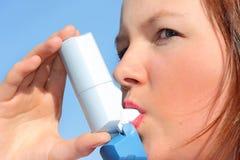 Teenage girl using inhaler royalty free stock photography