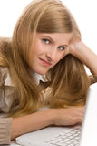 Teenage girl using laptop Stock Image