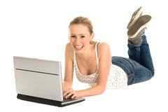 Teenage girl using laptop Stock Images