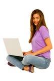 Teenage girl using laptop Stock Photos