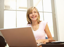 Teenage Girl Using Laptop At Home Royalty Free Stock Photo