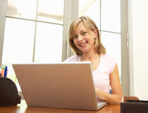 Teenage Girl Using Laptop At Home Royalty Free Stock Photos