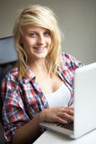 Teenage Girl Using Laptop At Home Stock Photography
