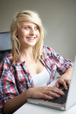 Teenage Girl Using Laptop At Home Stock Photos