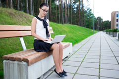 Teenage Girl Using Laptop In Park Or Campus Royalty Free Stock Photo