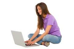 Teenage girl using laptop Stock Image