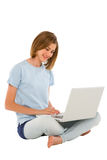 Teenage girl using laptop Royalty Free Stock Images