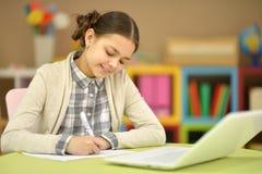 Teenage girl using a laptop Stock Photo