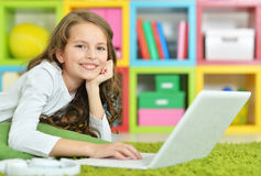 Teenage girl using a laptop. Portrait of a teenage girl using a laptop royalty free stock photos