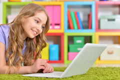 Teenage girl using a laptop Royalty Free Stock Images