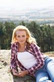 Teenage Girl Using Mobile Phone In Countryside Stock Image