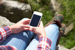 Teenage Girl Using Mobile Phone In Countryside Stock Photo