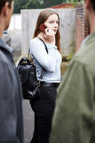Teenage Girl Using Mobile Phone Feels Intimidated As She Walks Home Royalty Free Stock Photo