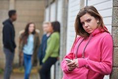 Teenage Girl Using Mobile Phone In Urban Setting Royalty Free Stock Image