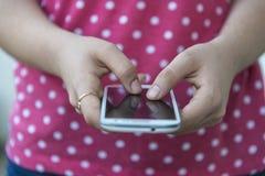 Teenage girl using mobile smart phone Royalty Free Stock Photo