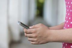 Teenage girl using mobile smart phone Stock Images