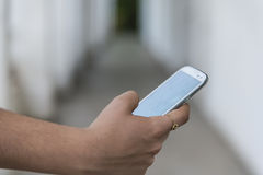 Teenage girl using mobile smart phone Stock Photo