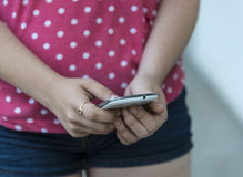 Teenage girl using mobile smart phone Royalty Free Stock Images