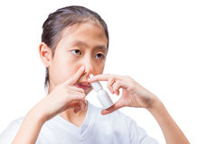 Teenage girl using nasal spray, white background Royalty Free Stock Images