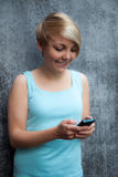 Teenage girl using smart phone Stock Image