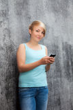 Teenage girl using smart phone Royalty Free Stock Photos