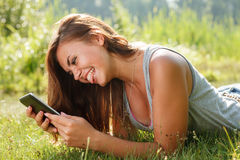 Teenage girl using tablet pc Stock Photos