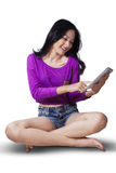 Teenage girl using tablet in studio Royalty Free Stock Photography