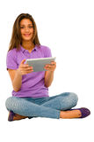 Teenage girl using tablet Royalty Free Stock Image
