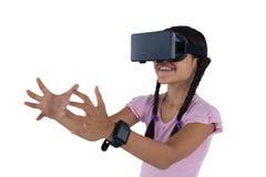 Teenage girl using virtual reality headset Stock Photos