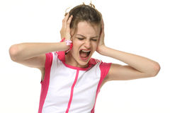 Teenage girl in very bad mood. Hysterics. Portrait on white background stock photography