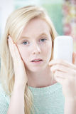 Teenage Girl Victim Of Bullying By Text Message Stock Photos