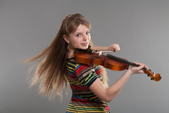 Teenage girl with violin Stock Images