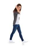 Teenage girl walking by Stock Photos