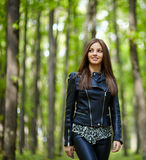 Teenage girl walking in the forest park Stock Photo