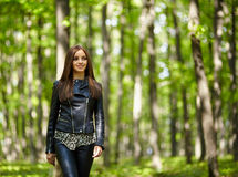 Teenage girl walking in the forest park Royalty Free Stock Photos