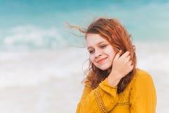 Teenage girl walking on the ocean coast Royalty Free Stock Photos