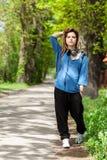 Teenage girl walking in park Royalty Free Stock Images