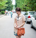 Teenage girl walking in the street Royalty Free Stock Images