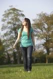 Teenage Girl Walking Through Summer Meadow Stock Image