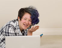Teenage girl wants to be left alone while using her cell phone a Royalty Free Stock Photo
