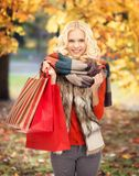 Teenage girl in warm clothes with shopping bags Stock Image