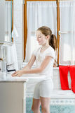 Teenage girl washing her hands Stock Images