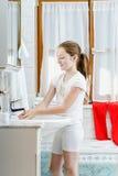 Teenage girl washing her hands Stock Images