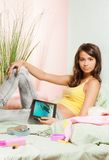 Teenage girl watching photos from tablet pc Stock Photography