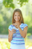 Teenage girl with water bottle Royalty Free Stock Images