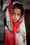 Teenage girl wear a carpet. Annapurna sanctuary village farmland  Nepal teenage girl wear  carpet Royalty Free Stock Image