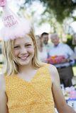Teenage Girl Wearing Birthday Cap Stock Photo