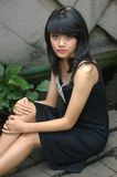 Teenage girl wearing black gown Stock Photos