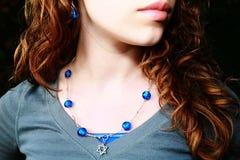 Teenage girl wearing blue stone necklace Stock Image