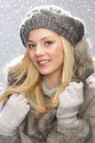 Teenage Girl Wearing Cap And Fur Coat In Studio stock photos